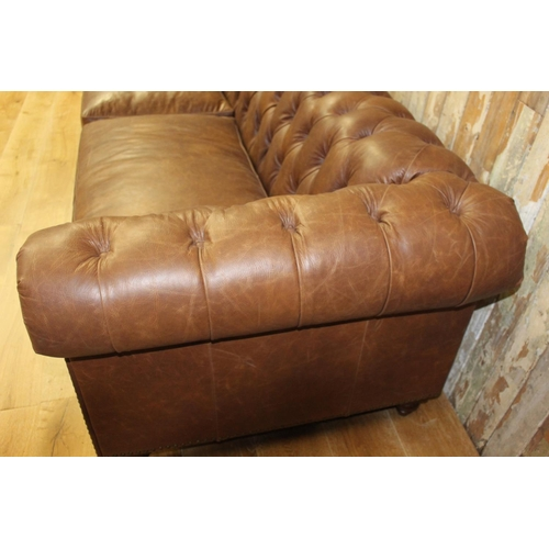 7 - Leather upholstered deep buttoned four seated Chesterfield sofa. {70 cm H x 250 cm W x 90 cm D}...