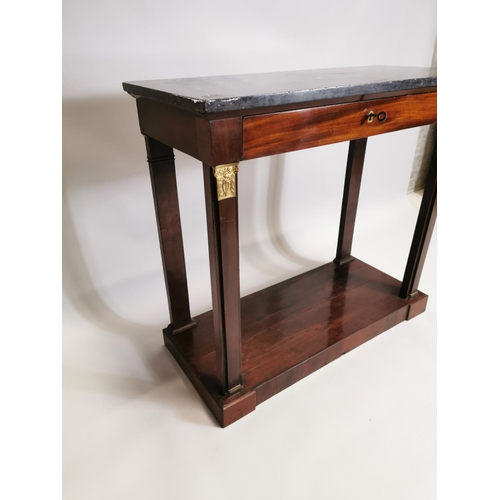 11 - 19th. C. mahogany side table, the marble top above a single drawer raised on square pillars decorate...