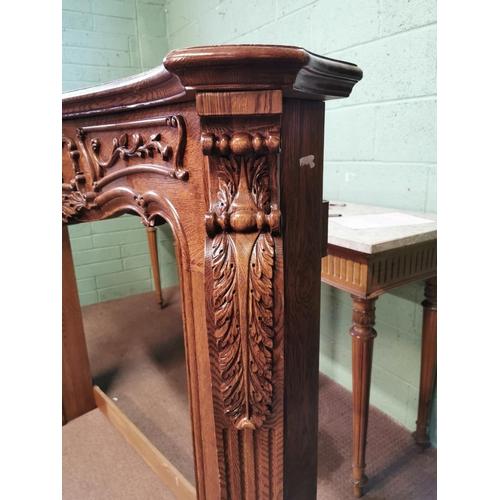 30 - Carved oak chimney piece . { 134cm H X 170cm W X 28cm D }.