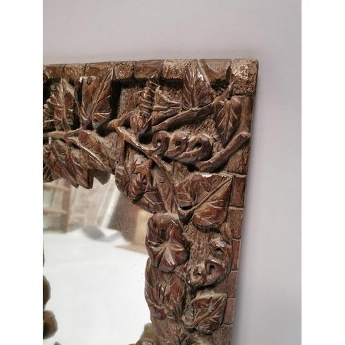 35 - Decorative early 20th. C. carved oak wall mirror. { 56cm H X 40cm W }.