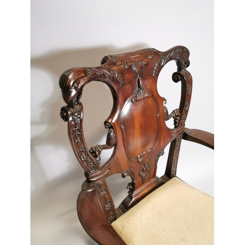 38 - Good quality carved mahogany open arm chair, decorated with Phoenix,  in the Irish Georgian manner{1...
