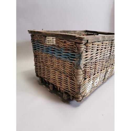 43 - Wicker log basket { 40cm H X 70cm W X 50cm D }.