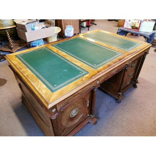 47 - 19th. C. mahogany partner's desk, the top with three inset tooled leather panels above the centre fr...