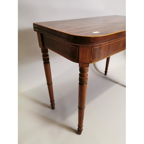 50 - 19th. C. mahogany turn over leaf card table with single drawer in the frieze, raised on turned legs ...
