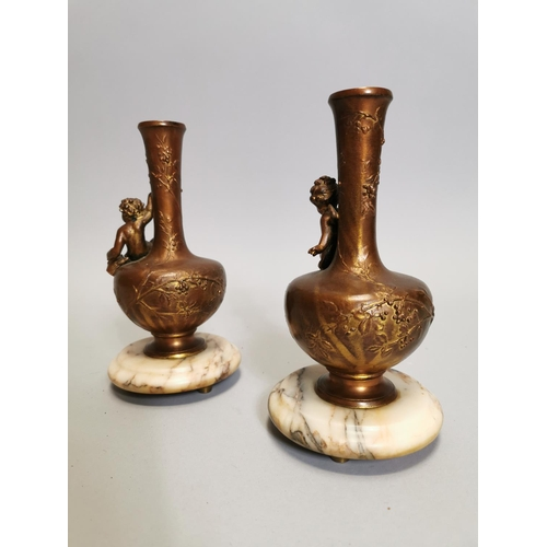 53 - Pair of spelter and marble vases decorated with foliage and a seated cherub { 21cm H X 10cm Dia. }