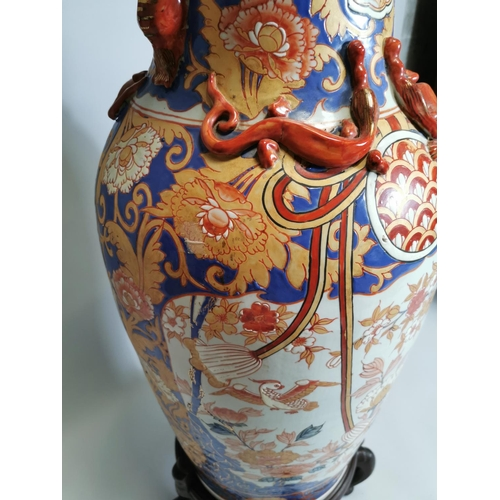 56 - Oriental ceramic vase mounted on betook wood stand { 115cm H X 39cm Dia }.