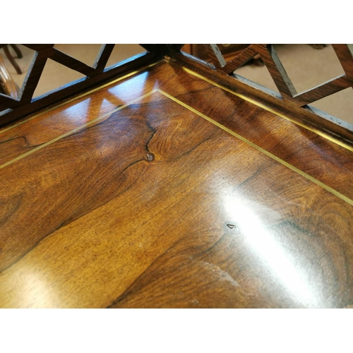 57 - Pair of Edwardian rosewood side tables, the open work gallery back above brass inlaid frieze raised ...