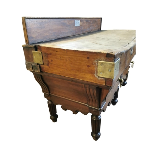 60 - 19th. C. French butcher's block, with gallery back and two deep drawers in the frieze raised on turn...