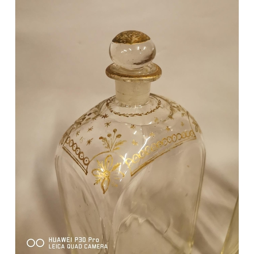 12 - Pair of early 19th C. glass decanters with hand painted gilt decoration {29 cm H x 12 cm W x 9 cm D ...
