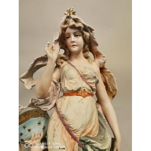 16 - Large ceramic figural group of a Maiden and Cherub {48 cm H x 23 cm W}.