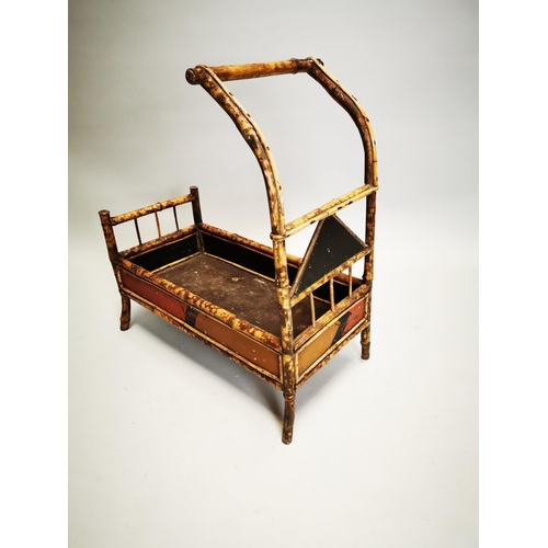 19 - Unusual early 20th C. bamboo doll's cot with hand painted Oriental handles { 67 cm H x 37 cm L cm 22...