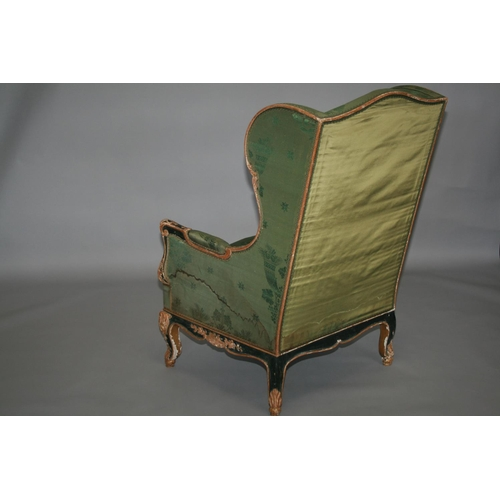 21 - 19th Century gilt and painted wing back chair with some distressing 76 W x 112 H x 80 D