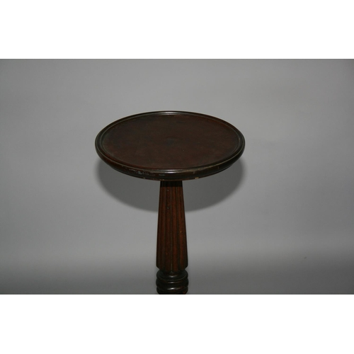 33 - 19th Century mahogany torchiere with circular top on tapering support 40 W x 84 H