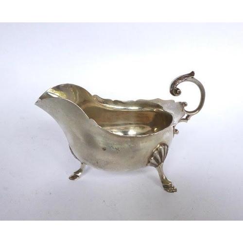 "5 - Plain oval silver sauceboat on three hoof feet. Length: 6"". Weight: 6ozs. Sheffield 1911 Maker: Walk..."