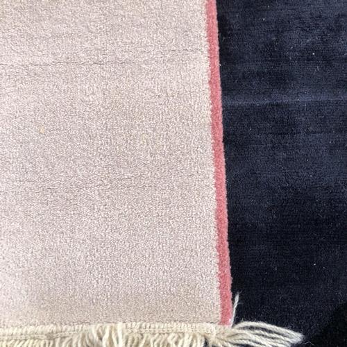56 - Cream carpet runner with pink edge 275 x 138
