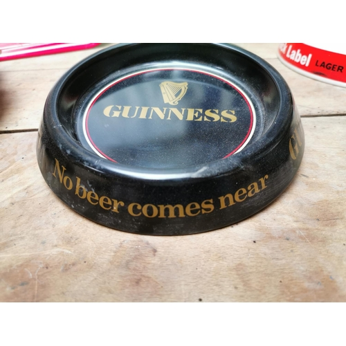 20 - Collection of seven tinplate Guinness advertising ashtrays {20 cm Dia.}.