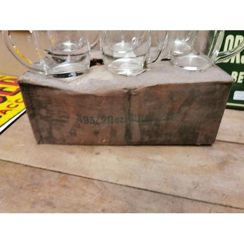 24 - Six Guinness glass tankards in original box.