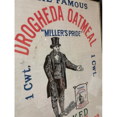29 - Framed The Famous Drogheda Oatmill advertising cloth {88 cm H x 62 cm W}.