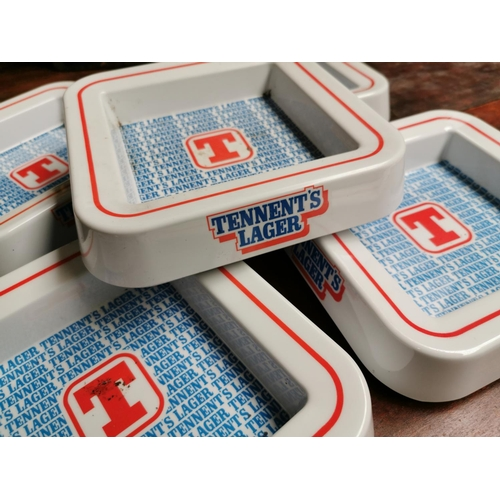 45 - Five Tennent's Lager advertising ashtrays {19 cm H x 19 cm W}.