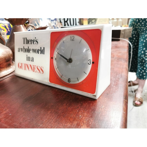 48 - 1950s There's A Whole World In A Guinness Perspex advertising clock {15 cm H x 32 cm W x 7 cm D}.