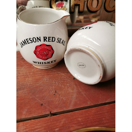 8 - Pair of Jameson Red Seal Whiskey Arklow pottery advertising jugs {10 cm H x 13 cm W x 10 cm D}.