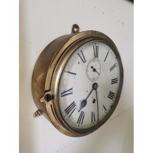 33 - 19th. C. brass ship's clock. { 25cm Dia }.