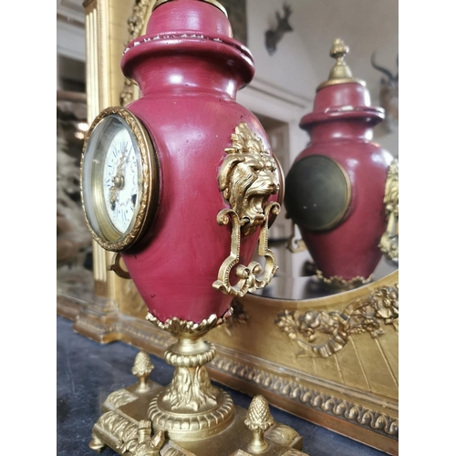 60 - 19th. C. gilded brass and ceramic mantle clock, in the form of a lidded urn { 38cm H X 20cm W X 13cm...