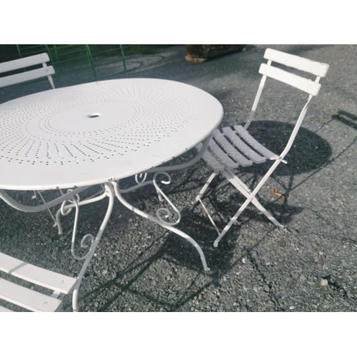 7 - Early 20th C. wrought iron garden table and three matching chairs {table 72 cm H x 96 cm Dia. and ch...