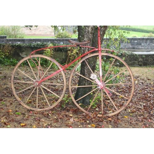 10 - Rare 18th C. boneshaker bicycle {132 cm H x 183 cm W x 62 cm D}.