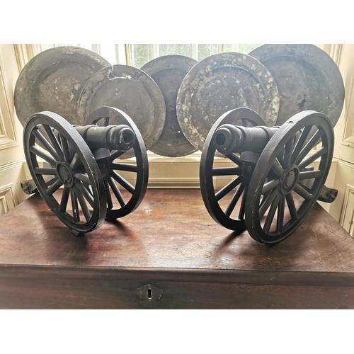 18 - Pair of metal table cannons. { 23cm H X 27cm L X 22cm D }.