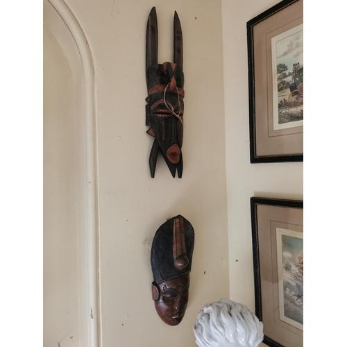 22 - Two Polynesian face masks { 56cm H X 17cm W  & 43cm H X 17cm W approx  }.