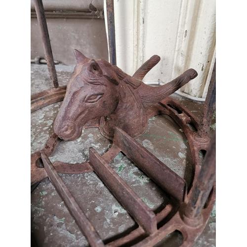 26 - 19th. C. cast iron boot scraper and stand. { 40cm H X 33cm W X 34cm D }.