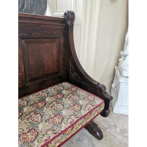 35 - 19th. C. carved oak hall seat with three raised panels. { 111cm H X 145cm W X 56cm D }.