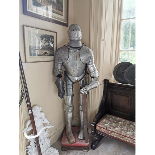 36 - Early 20th. C. metal suit of armour on stand { 194cm H X 72cm W X 30cm D }.
