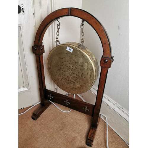 52 - 19th. C. brass dinner gong mounted on an oak stand, in the Gothic manner. { 94cm H X 61cm W X 22cm D...