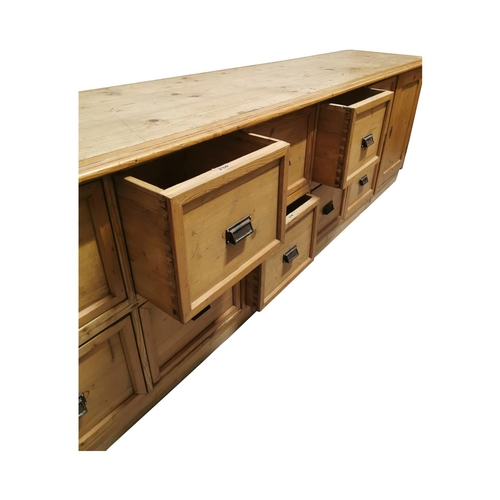 1 - Good quality pine shop counter bank of drawers. The top with three inset wide planks above six drawe...