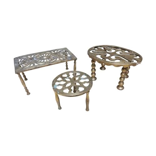 26 - Three brass trivets {12cm H, 10cm H and 12cm H}