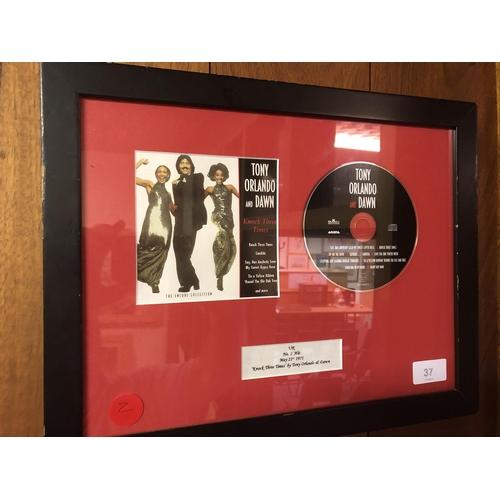 37 - Tony Orlando & Dawn Uk hit CD in frame, Knoch three times by Tony Orlando & Dawn May 21st 1971...