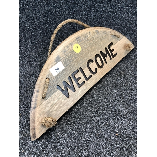 36 - Wooden hanging welcome sign made from barrel top...