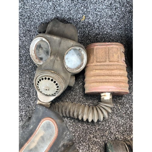 39 - Box containing 4 genuine WW1 gas masks with filter canisters and set of WW2 Merchant Navy Chief Engi...