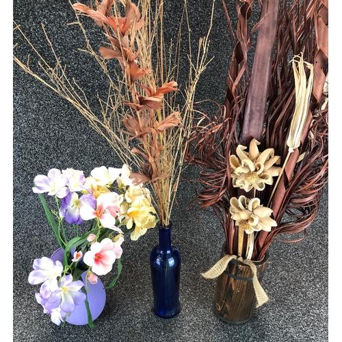 23 - Set of 3 decorative plastic plant arrangements in vases and bottle...