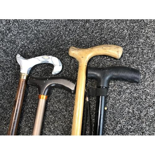 45 - Set of 4 walking canes...