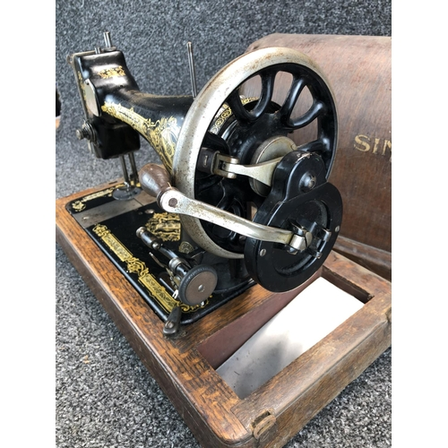 52 - Vintage Singer sewing machine in black and gold colour scheme with wooden case...