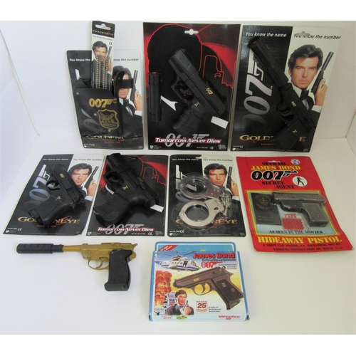JAMES BOND COIBEL & LONE STAR/WICKE replica pistols, handcuffs, holster and caps. Excellent Plus to Mint on Excellent Cards. (9)