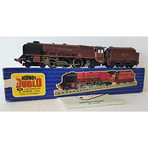 HORNBY-DUBLO 3-Rail 3226 'City of Liverpool' Loco & Tender (with Caledonian Headboard). Minor paint chips. Good Plus in a Very Good to Excellent Box (marks on end where tape removed) with instructions.