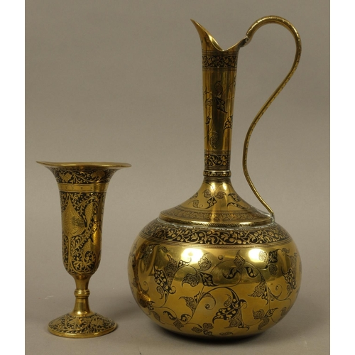 13 - AN INDO PERSIAN BRASS AND BLACK ENAMEL EWER with globular body, tall tapered neck and scroll handle,...
