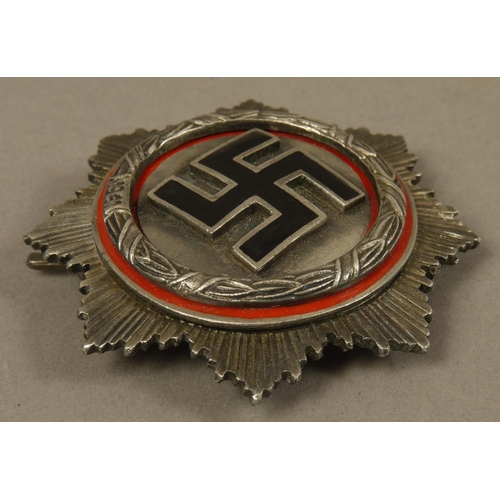 30 - GERMAN CROSS, white metal with black enamel Swastika, red enamel border with cast wreath inscribed 1...