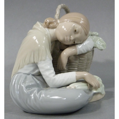 23 - A Lladro figure of a country girl sat leaning on her basket of vegetables, 14cm high...