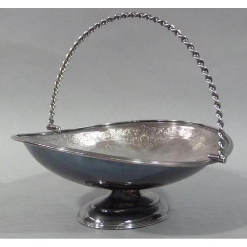 7 - An Edwardian silver plated fruit basket by Mappin & Webb London, of oval outline with twisted swing ...