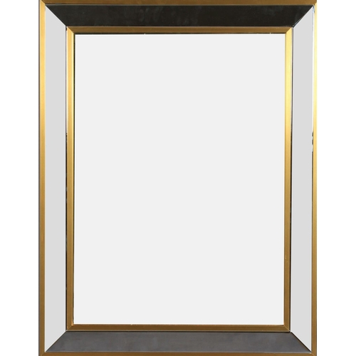 47 - Renato Zevi c.1970s, a brass and chrome framed wall mirror, the rectangular plate within a chamfered...